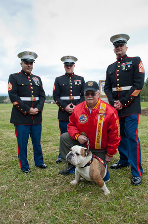 Marines at the cermony, active and retired, and oe Devil Dog named Gunny!